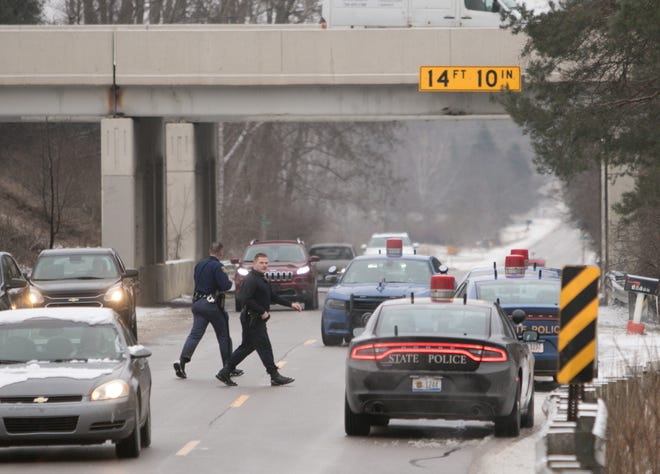 Michigan State Police show a presence on Hyne Road west of U.S. 23 Monday, Jan. 13, 2020 in Brighton Township. Three people were arrested after a robbery at the Target store in Fenton.