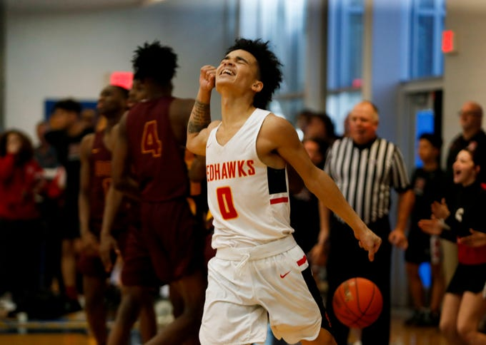 Seneca's Darian Floyd celebrates after making the game winning basket against Doss on the first day of the Louisville Invitational Tournament on Jan. 13, 2020.