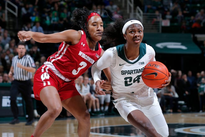 Michigan State's Nia Clouden, right, drives against Wisconsin's Suzanne Gilreath (3) during an NCAA women's basketball game on Sunday, Jan. 12, 2020, in East Lansing, Mich. (AP Photo/Al Goldis)