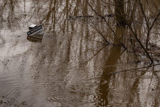 Flooding seen near the bridge on M-43 near downtown Williamston, Monday, Jan. 13, 2020.