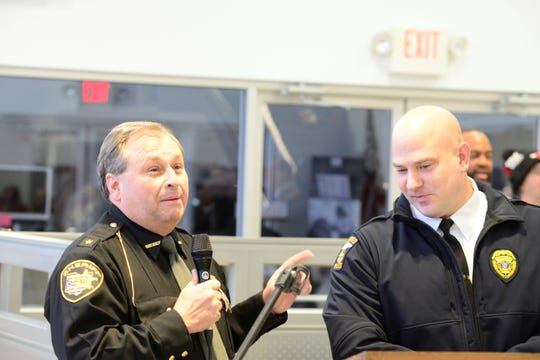 """Richland County Sheriff Steve Sheldon, left, and Mansfield Chief of Police Keith Porch speak at Sunday's kickoff of """"Spread the Light"""" week."""