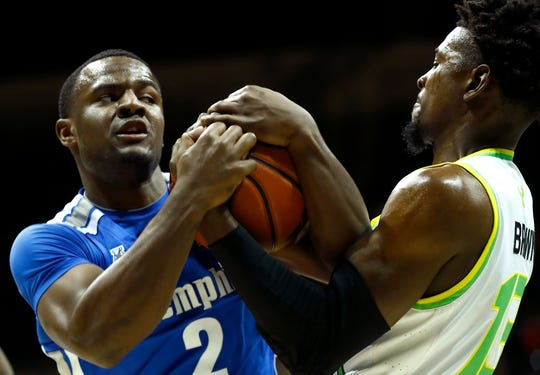 Memphis Tigers guard Alex Lomax battles for the ball with South Florida forward Justin Brown during their game at the Yuengling Center in Tampa, Fla. On Sunday, Jan. 12, 2020.