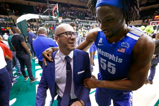 Memphis Tigers Assistant Coach Cody Toppert and Precious Achiuwa share a laugh after their comeback, 68-64 win over South Florida at the Yuengling Center in Tampa, Fla. On Sunday, Jan. 12, 2020.