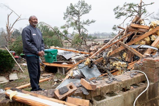 Larry Woods looks over the debris surrounding his home Monday, Jan. 13, 2020, in Hernando. Woods' house was hit by a tornado early Saturday morning.