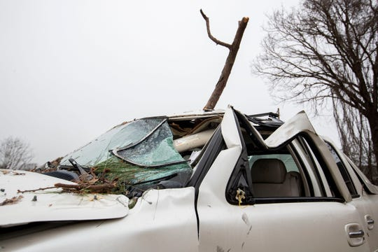A damages SUV sits behind Larry Woods' home Monday, Jan. 13, 2020, in Hernando.