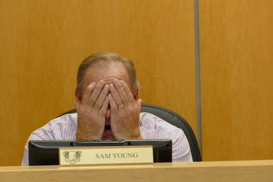"Sam Young, Marco Island city councilor, said the city has 1,300 Suntree stormwater filters which don't work. ""Why would you go to Suntree filters?"" Young said. In the picture, Young partially covers his face with his hands during a City Council meeting on Jan. 6."