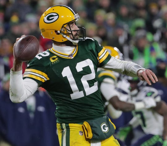 Green Bay Packers quarterback Aaron Rodgers throws deep during the third quarter of their divisional playoff game Sunday, January 12, 2020 at Lambeau Field in Green Bay, Wis. The Green Bay Packers beat the Seattle Seahawks 28-23.