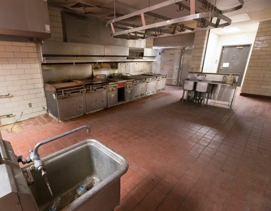 The unused kitchen in the basement of the building A complex of the former Columbia Hospital is shown on Friday. The university purchased the complex in 2010 and is seeking to demolish the building A complex.