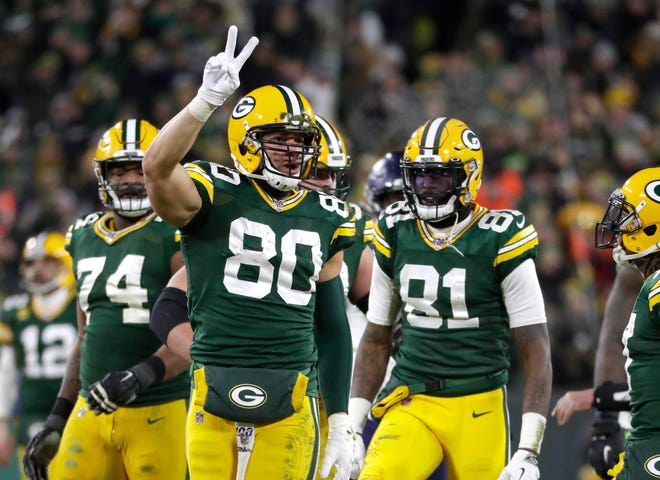 Green Bay Packers tight end Jimmy Graham (80) makes a crucial first down in the 4th quarter during  the Green Bay Packers 28-23 win over the Seattle Seahawks to advance to the Divisional playoff game Sunday, January 12, 2020 at Lambeau Field in Green Bay, Wisconsin.