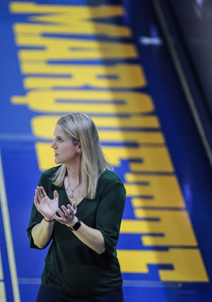Marquette head coach Megan Duffy cheers her team against Seton Hall in a Big East women's game Jan. 12 at the Al McGuire Center. MU won, 81-60.