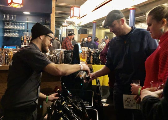 Henry Schwartz, president of MobCraft,  pours samples at the WinterWhales Rare Beer Fest. He said to look for the continued growth of lower alcohol beers.
