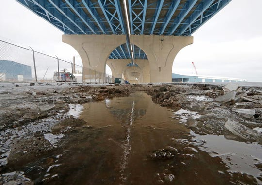 Pavement is damaged due to flooding over the weekend at the Port of Milwaukee in Milwaukee on Monday, Jan. 13, 2020. The port likely sustained millions of dollars in damage as a result of the weekend storm that brought a 54 mph wind gust along the lake shore. There is damage throughout the port and 70% of Jones Island was flooded as a result of the storm. The port handles an average of 2 million tons of freight each year.