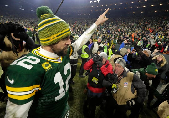 Green Bay Packers quarterback Aaron Rodgers (12) points to the fans after the Green Bay Packers 28-23 win over the Seattle Seahawks to advance to the NFC championship game.