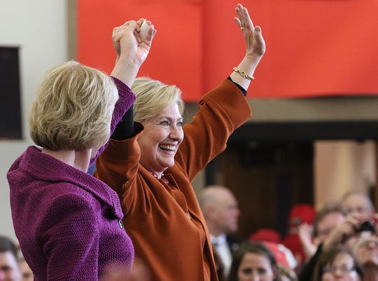 Democratic presidential candidate Hillary Clinton, right, is introduced by Sen. Tammy Baldwin, D-Wis., at a Clinton campaign appearance Saturday, April 2, 2016 at The Lismore Hotel in downtown Eau Claire, Wis.