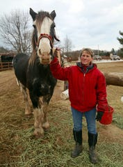 Cindy Kanarowski-Peterson stands with one of her horses, Shadow, at Red Ridge Ranch outside Mauston on Jan. 9, 2020.