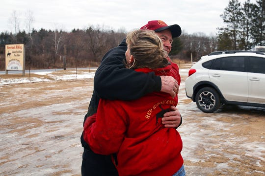 Harlan Wienke hugs Cindy Kanarowski-Peterson at Red Ridge Ranch outside Mauston on Jan. 9, 2020, after he drove from his home in New Richmond to donate a truckload of hay to the ranch.