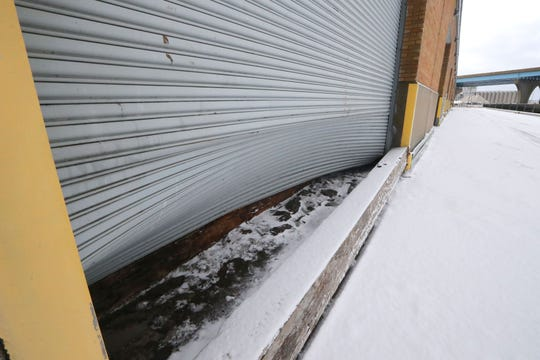 A terminal overhead door was bent in due to flooding over the weekend at the Port of Milwaukee in Milwaukee on Monday, Jan. 13, 2020. The port likely sustained millions of dollars in damage as a result of the weekend storm that brought a 54 mph wind gust along the lake shore. There is damage throughout the port and 70% of Jones Island was flooded as a result of the storm. The port handles an average of 2 million tons of freight each year.