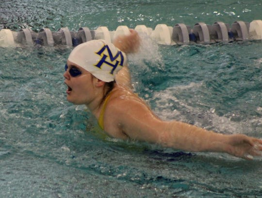Mountain Home's Lindsey Gardner competes in the 100 fly on Saturday at Little Rock.