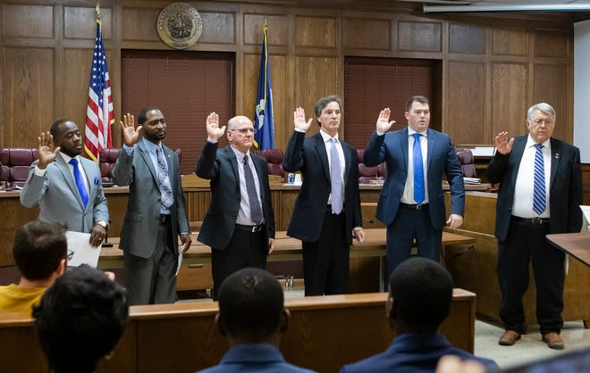 Members of the Ouachita Parish Police Jury swear in at the first meeting of the year held at the Ouachita parish courthouse on Jan. 13.