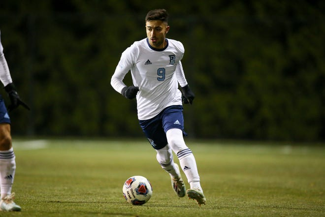 Rhode Island striker Stavros Zarokostas brings the ball up the field during an Atlantic-10 home game against Davidson. (Photo/Stew Milne)