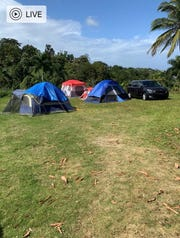 Terri Orama and her family sleep in tents in their backyard following a string of earthquakes that struck Puerto Rico last week.