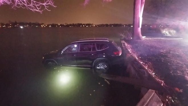 A driver was cited for careless driving after driving off the road and into Lake Parsippany. She was checking her GPS when the accident occurred, police say.