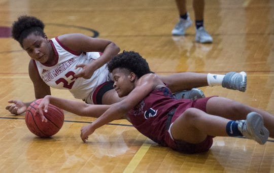 Stanhope Elmore's Kaleiah Hollis (23) and Park Crossing's Ashanti Wood (3) dive for a loose ball at Stanhope Elmore High School in Millbrook, Ala., on Monday, Jan. 13, 2020.