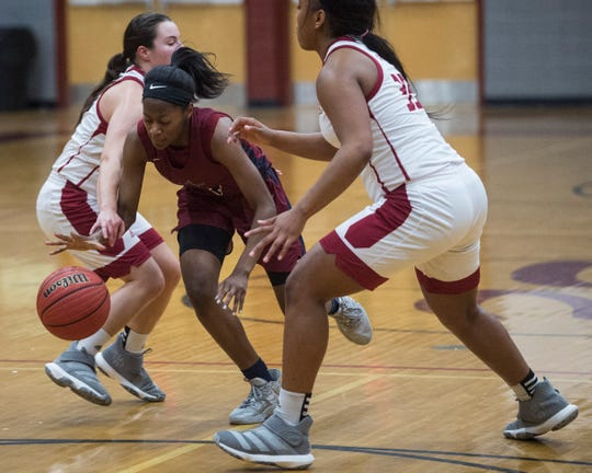 Park Crossing's Alexis Andrews (4) cuts through defenders at Stanhope Elmore High School in Millbrook, Ala., on Monday, Jan. 13, 2020.