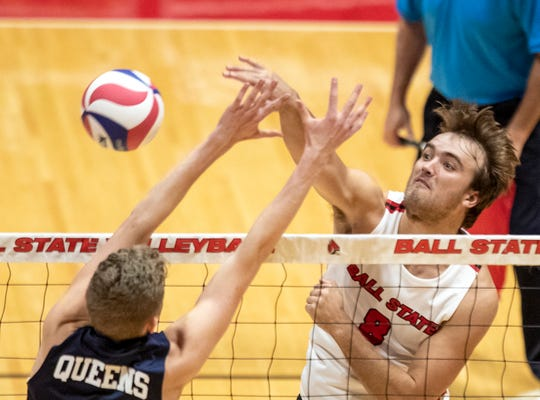 Ball State senior outside attacker Blake Reardon hits a ball past a Queens defender during a match the Cardinals' would win this past weekend.
