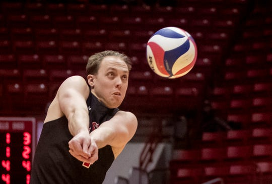 Ball State senior libero Nick Lavanchy goes for a ball during a recent match.
