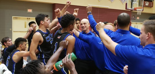 The Community School of Naples boys basketball team comes out of a timeout during a 48-38 win at First Baptist on Friday, Jan. 10, 2020.