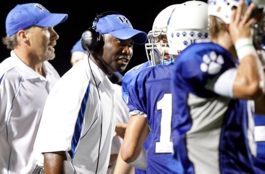 Barron Collier defensive coordinator Johnny Smith coaches during a 2009 football game. Smith recently was hired as the head football coach at Immokalee High, where he was a star running back in the late 1980s.