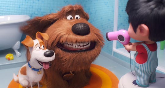 """Max the terrier (voice of Patton Oswalt), left, and Duke the mutt (Eric Stonestreet) must get used to a toddler in the family in """"The Secret Life of Pets 2."""""""