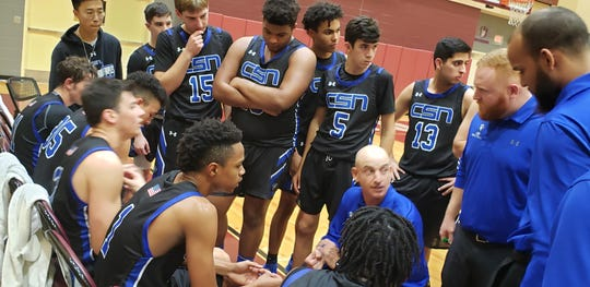 Community School of Naples boys basketball coach Greg Donahue talks to his team during a timeout in a game at First Baptist Academy on Friday, Jan. 10, 2020. CSN won 48-38 to extend its winning streak to 12 games.