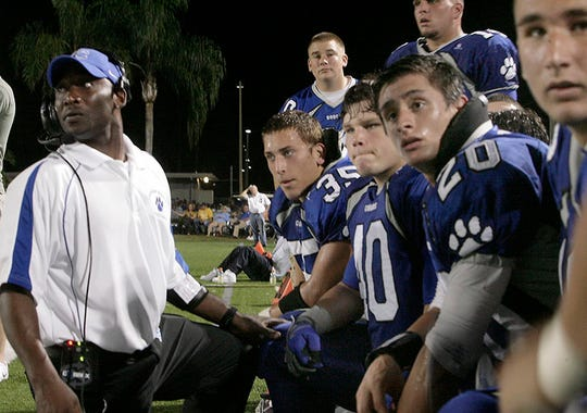 Barron Collier assistant coach Johnny Smith on the sidelines during a 2009 game. Smith recently was hired as the head football coach at Immokalee High, where he was a star running back in the late 1980s.