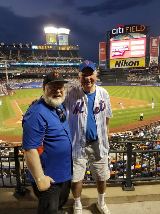 Father Paul Keenan (the church's parochial vicar) with parishoner Jack Nagel (in Mets shirt) at CitiField last August