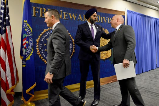 At left, New Jersey Attorney General Grubir Grewal shakes hands with Craig Carpenito, U.S. Attorney for the District of New Jersey, after a press conference with law enforcement agencies to update the public on the investigation of the Jersey City shooting, which occurred on December 10, 2019, as a press conference at FBI Newark Division Field Office in Newark, N.J. on Monday Jan. 13, 2020.