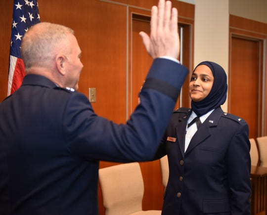 U.S. Air Force Chaplain Candidate Saleha Jabeen is commissioned by U.S. Air Force Chief of Chaplains (Maj. Gen.) Steven Schaick, Dec. 18, 2019 at the Catholic Theological Union, Chicago, Illinois. Jabeen is the first female Muslim Chaplain in the Air Force and Department of Defense.