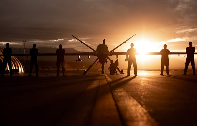 432nd Wing/432nd Air Expeditionary Wing Airmen pose with an MQ-9 Reaper at Creech Air Force Base, Nev., Nov. 19, 2019. The MQ-9 and its aircrew are one of the most demanded U.S. Air Force assets due to its ability to be employed primarily against dynamic targets and secondarily as an intelligence collection asset.  1