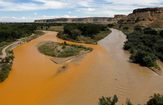 The confluence of the San Juan River is pictured Aug. 8, 2015 after the Gold King Mine spill. At left, is the contaminated Animas River, and at right is the San Juan River.