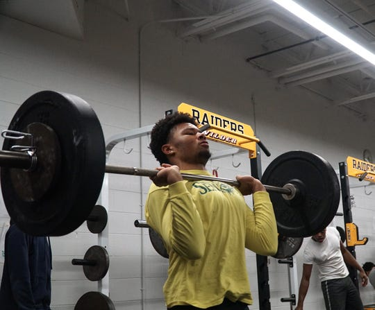 North Farmington High student Andrew Pooley lifts during a Jan. 13, 2020 training session.