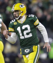 Green Bay Packers quarterback Aaron Rodgers (12) celebrates throwing a touchdown pass to Davante Adams (17) in the first half during their NFC divisional round playoff football game Sunday, January 12, 2020, at Lambeau Field in Green Bay, Wis.