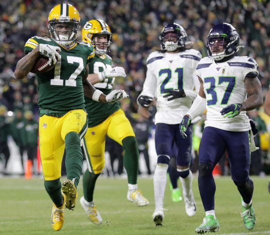 Green Bay Packers wide receiver Davante Adams (17) crosses the goal line following a reception in the third quarter against the Seattle Seahawks during their NFC divisional round playoff football game on Sunday, January 12, 2020, at Lambeau Field in Green Bay, Wis.  Wm. Glasheen/USA TODAY NETWORK-Wisconsin