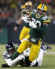 Packers tight end Jimmy Graham makes a reception against Seahawks strong safety Bradley McDougald during their NFC playoff game Jan. 12 at Lambeau Field.