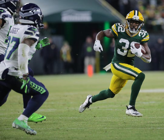 Green Bay Packers running back Tyler Ervin (32) runs for first down on a reverse during the firsts quarter of their divisional playoff game Sunday, January 12, 2020 at Lambeau Field in Green Bay, Wis. The Green Bay Packers beat the Seattle Seahawks 28-23.