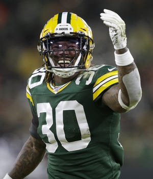 Green Bay Packers running back Jamaal Williams (30) is all smiles at the start of the second half against the Seattle Seahawks during their NFC divisional round playoff football game Sunday, January 12, 2020, at Lambeau Field in Green Bay, Wis.