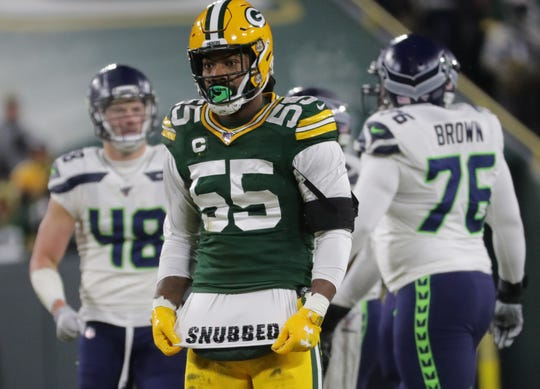 Green Bay Packers outside linebacker Za'Darius Smith (55) has a message on a shirt after sacking Seattle Seahawks quarterback Russell Wilson during the first quarter of their divisional playoff game Sunday, January 12, 2020 at Lambeau Field in Green Bay, Wis.