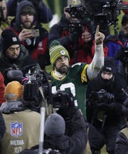 Green Bay Packers quarterback Aaron Rodgers (12) celebrates as he leaves the field after defeating the Seattle Seahawks during their NFC divisional round playoff football game Sunday, January 12, 2020, at Lambeau Field in Green Bay, Wis. The Packers won 28-23. Dan Powers/USA TODAY NETWORK-Wisconsin