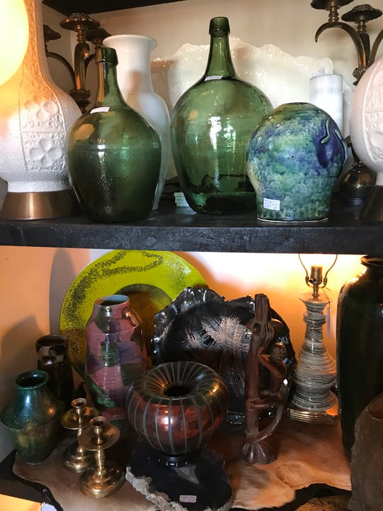 Colored glassware of all shapes and sizes remains a designer staple in 2020 antique trends.
