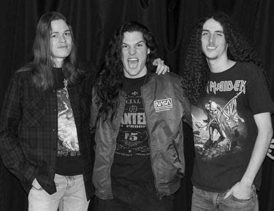 Members of the La Quinta metal band Instigator pose at the Desert Sun in Palm Springs, Calif. on Dec. 20, 2019. Jaxon Fischer (left) Mark Wadlund (center) and Garrison Calkins (right).